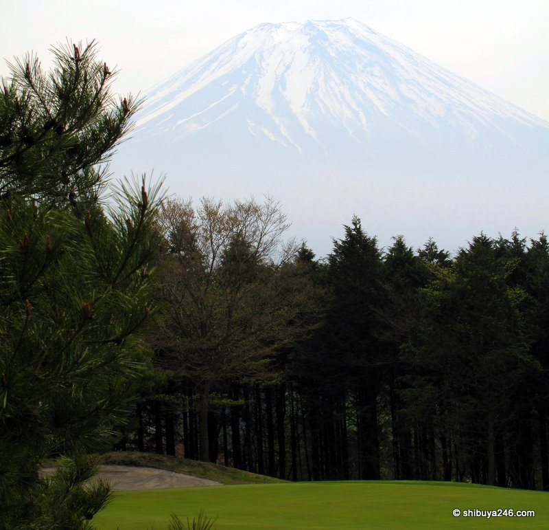 Mt Fuji rises above the golf course
