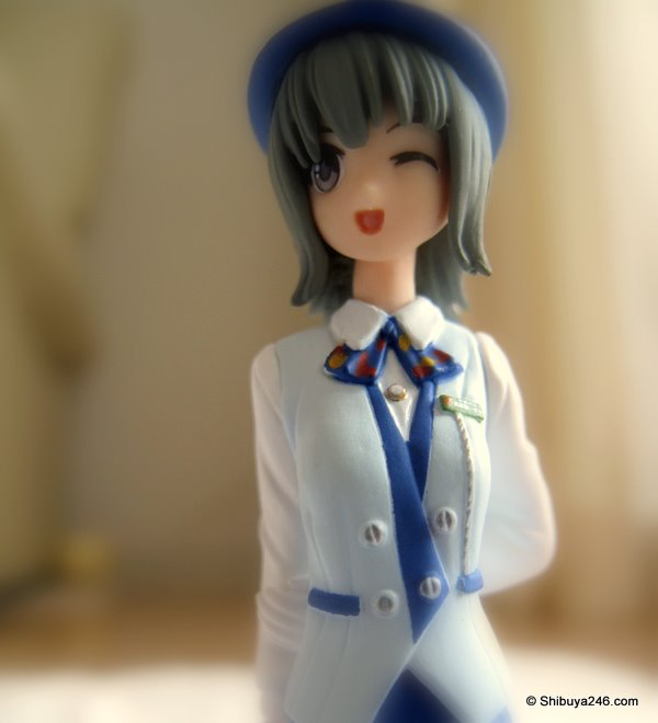 nice clean white a blue uniform with buttons