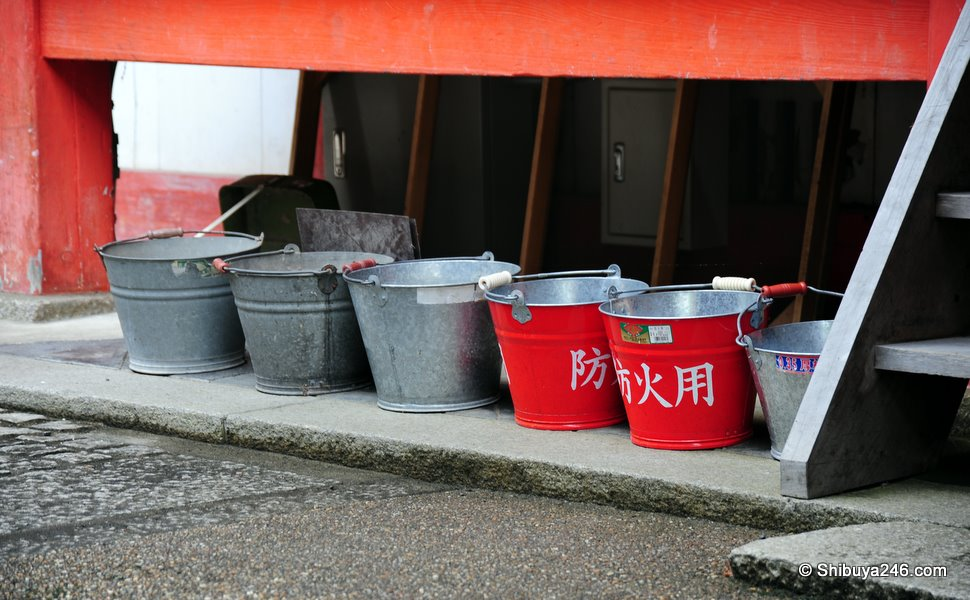 Bright red buckets in case of fire. I'm sure they have other ways of putting out fires as well as these buckets