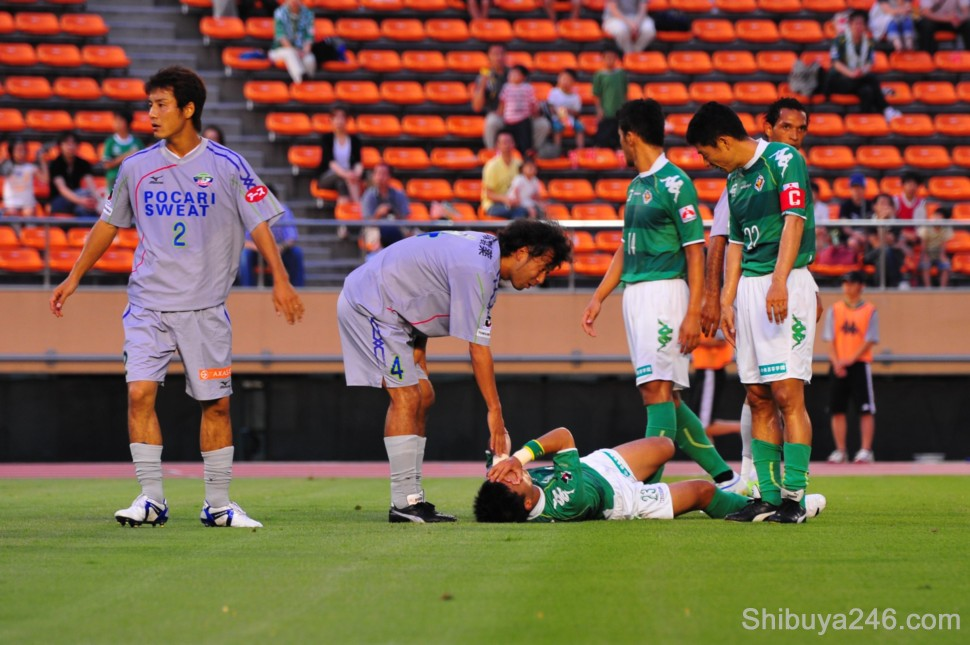 A Verdy player goes down after a hard tackle