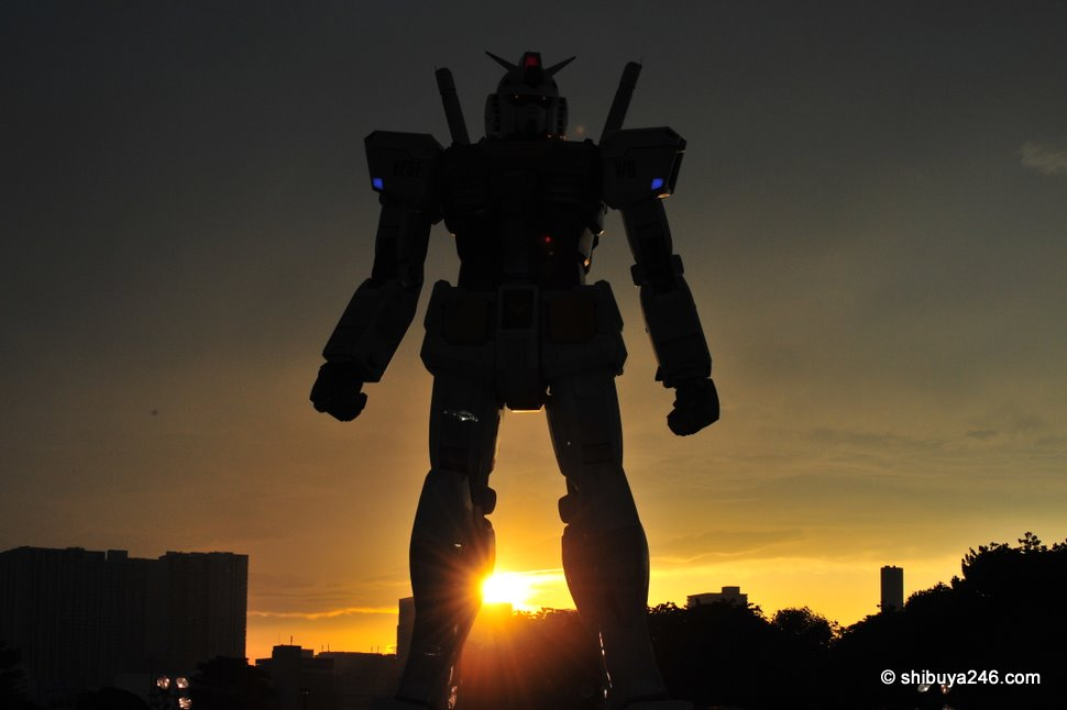 As the sun sets, Gundam awakes