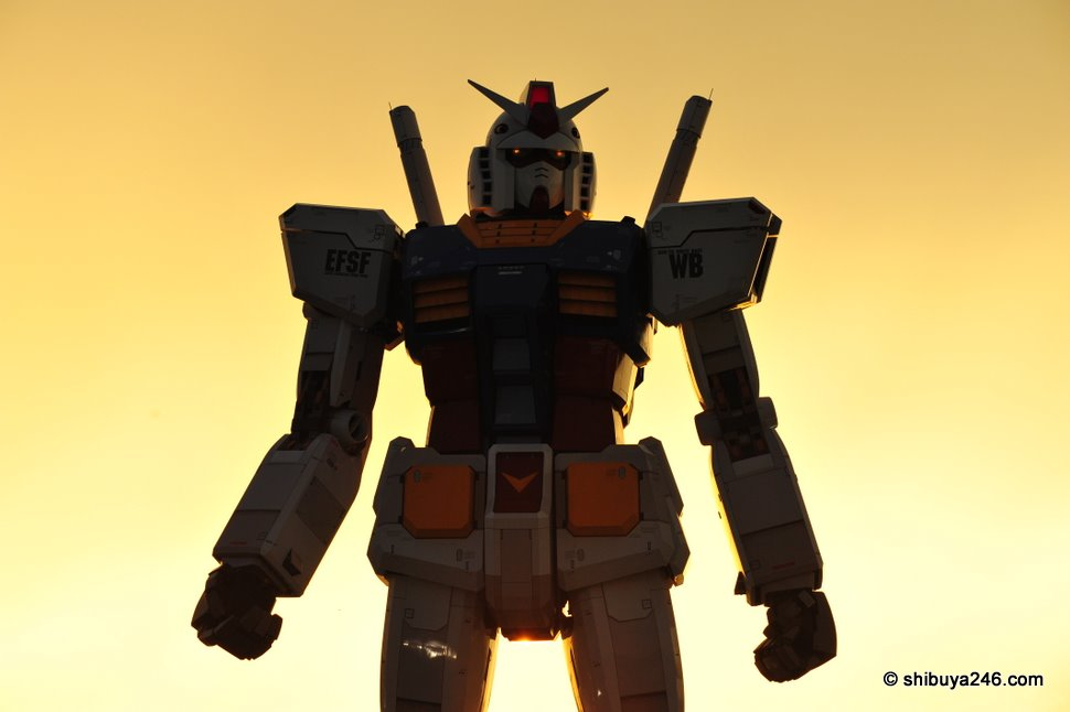 A Beautiful Sunset as the backdrop for Gundam to begin to stir and notice the crowd that has gathered