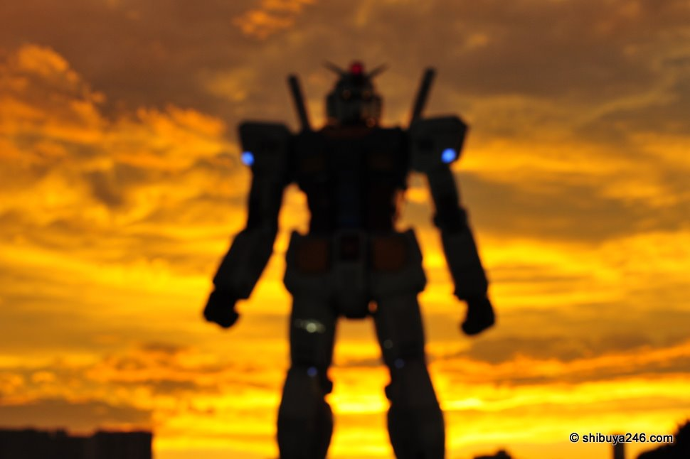 Through the haze and the clouds, Gundam approaches