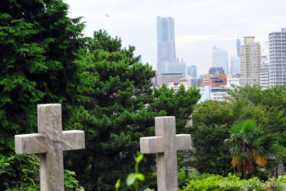 Gaijin Bochi, or Foreigners Cemetry dating back to mid 1800's, with The Landmark Tower in the background.