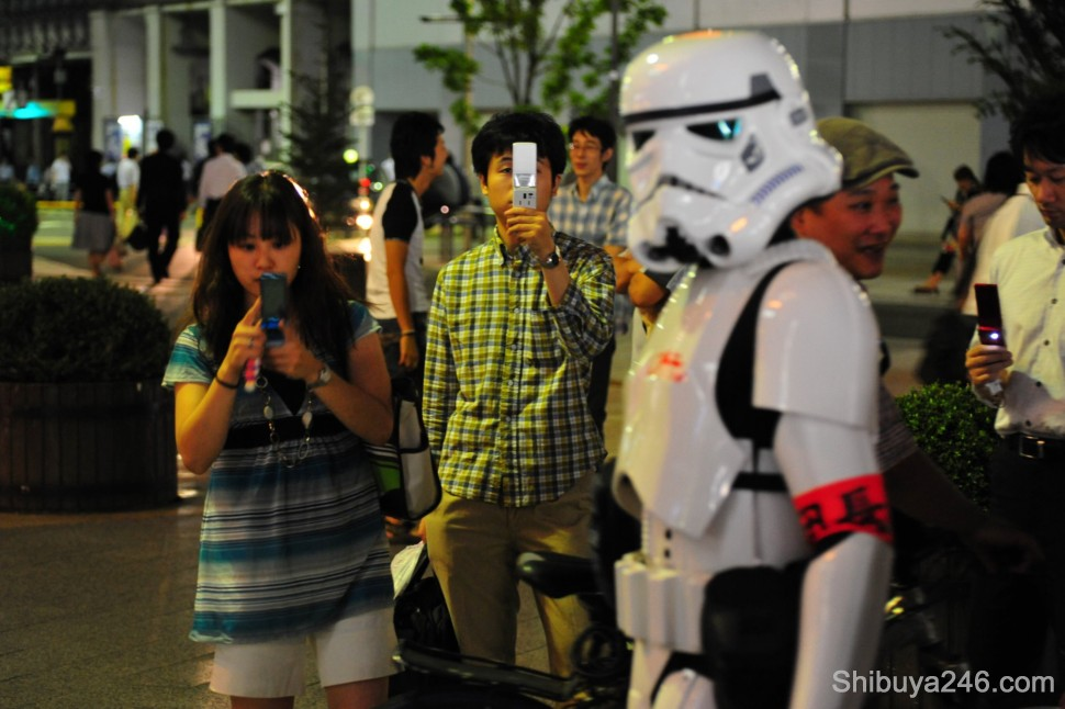 Mobile phones were the chosen weapon for most earthlings. The Stormtrooper kept his weapon holstered