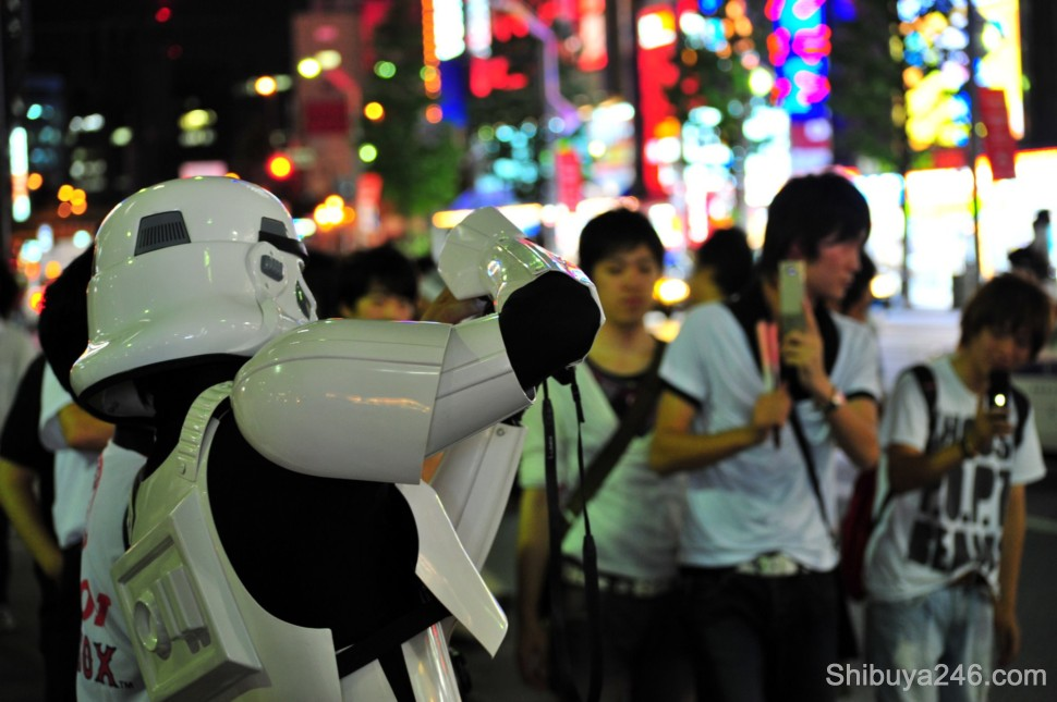 Those that are taken photos can quickly become the ones being taken. The stormtrooper fires off a few shots at the crowd