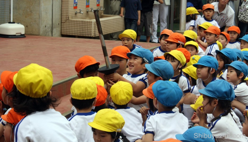 Holding the real Torch is an excitement for the kids