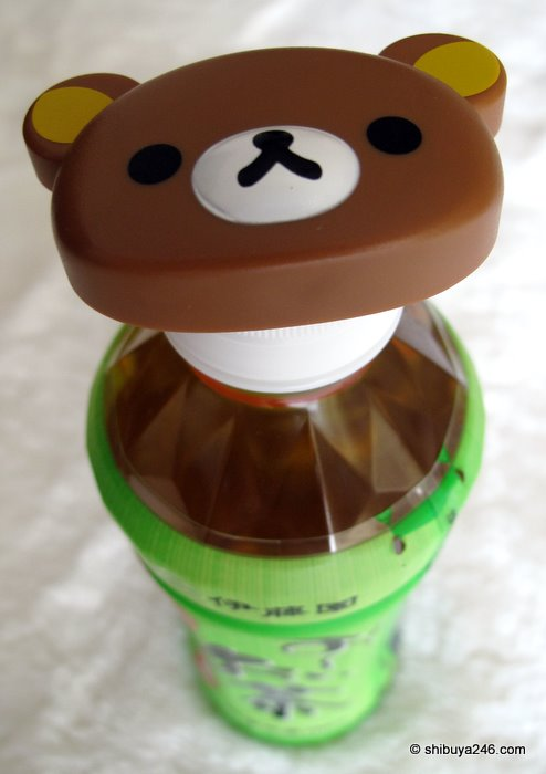 The rilakkuma bottle top opener in action