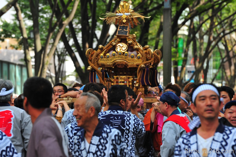 The mikoshi gets carried down the parade route