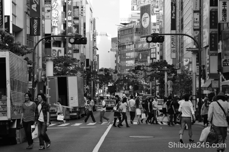 As the crowd clears the road gives way to the many shop signs, looking back here to Shibuya Station