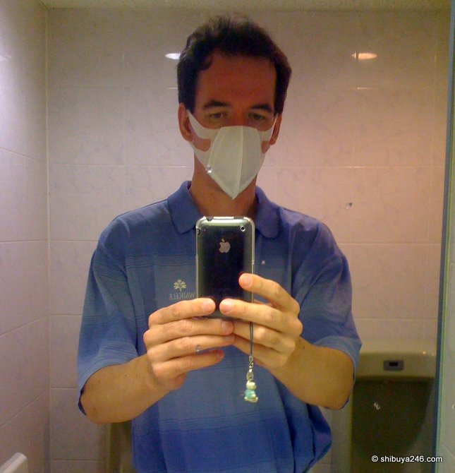 Waiting at the hospital with mask on, excuse the urinals in the background!
