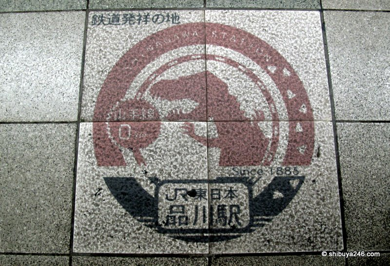 The Godzilla mark on the platform indicating Shinagawa Stations history since 1885