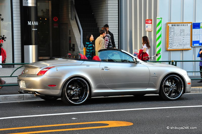 Everyone was taking a good look at this car. Nice set of wheels on this Lexus convertible