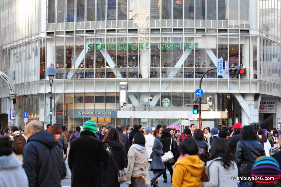 As always, loads of people scrambling across the Shibuya Crossing. Many heading for the warm comfort of Starbucks.