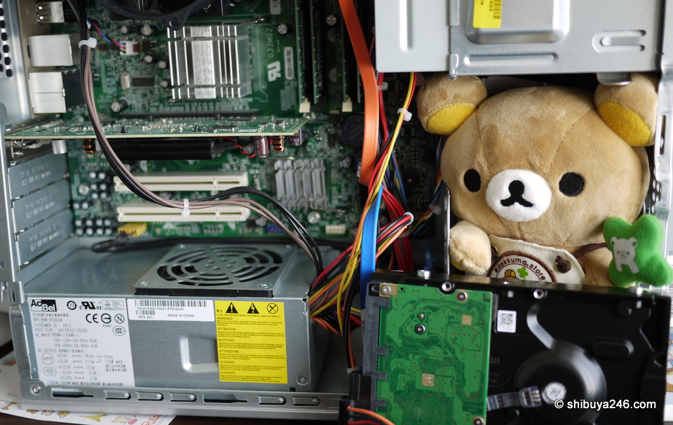 Rilakkuma helping fix my computer. He wanted to check the head room for the disk drive before we put in in.