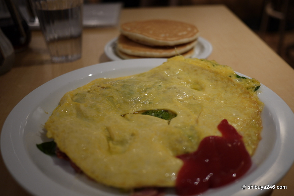 A spinach omlette at eggsnthings Harajuku, followed by a short stack of pancakes. Very tasty but a bit pricey.