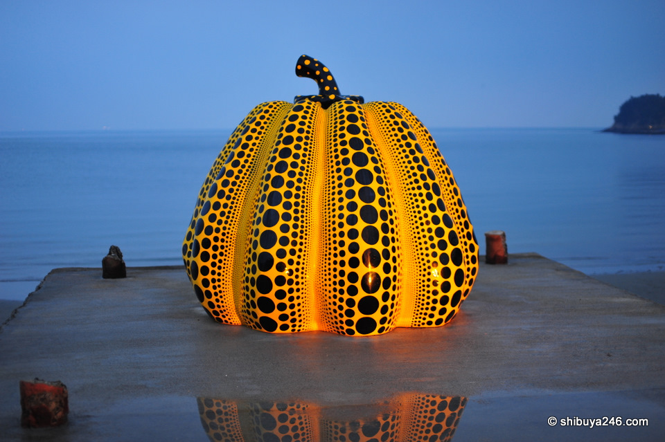 One of Kusama Yayoi's pumpkins sitting on the pier at Naoshima
